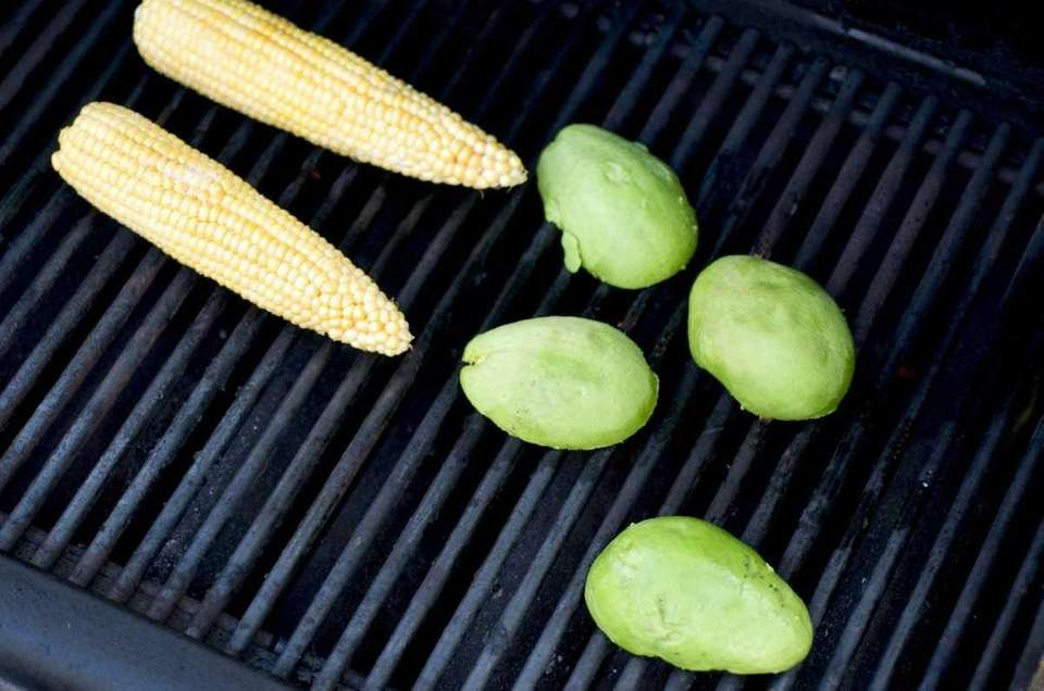 Avocado and corn are brushed with oil before