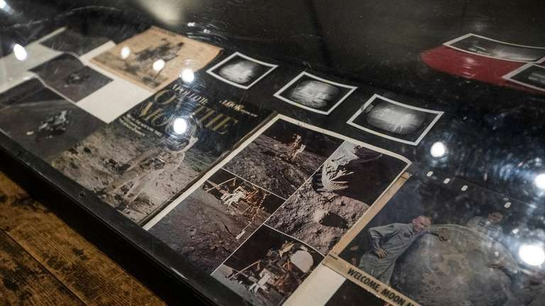 A glass case displays historical magazine clippings at