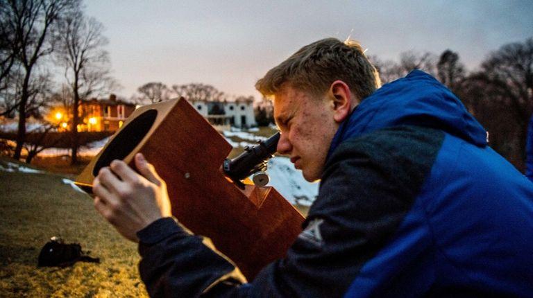 Matthew Kerner looks through a telescope recently at