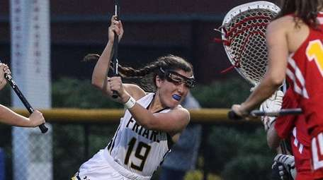 Katherine DeSimone of St. Anthony's leans in for
