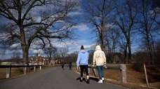 People stroll at Caumsett State Park in Huntington