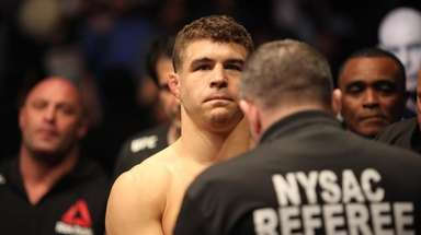 Al Iaquinta prepares to enter the octagon to