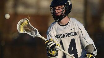 Colin Gleason #14 of Massapequa takes a pass