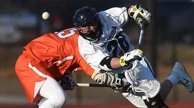 Angelo Petrakis #28 of Massapequa looks to pounce