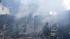 Firefighters battle a house fire on Yarnell Street