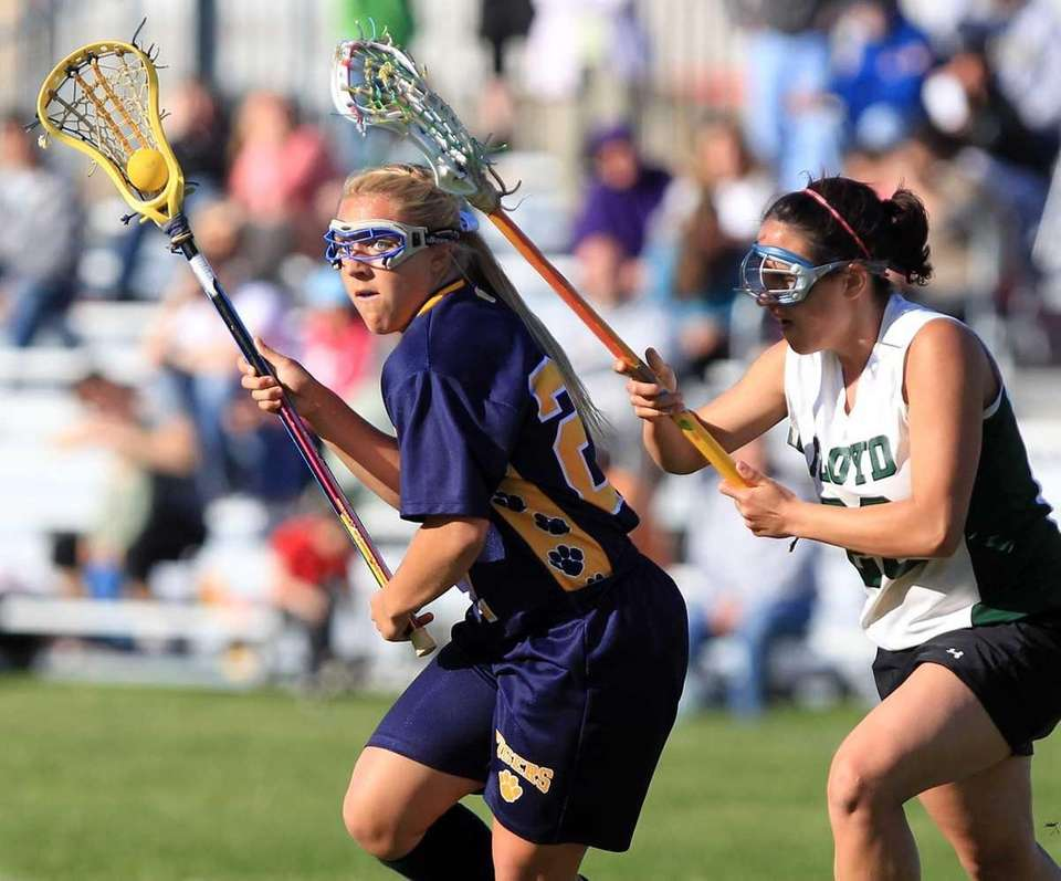 Northport's Emily Columbus (27) spins away from Floyd