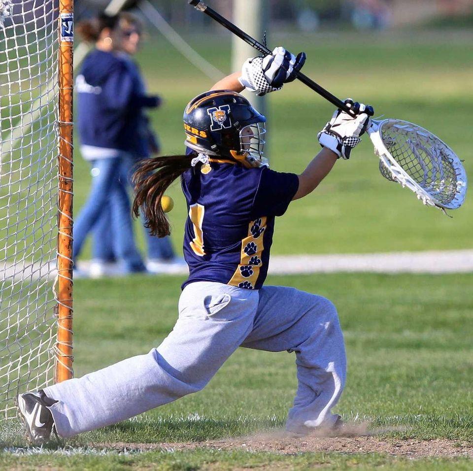 Northport goalie Michaela Aymong (1) deflects a shot