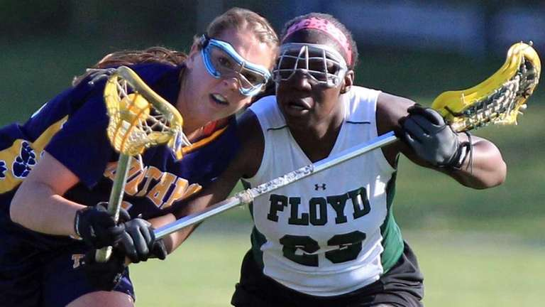 Northport's Shannon Gilroy (11) wins the draw against