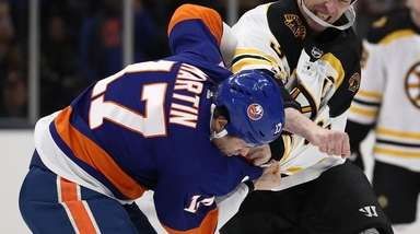Zdeno Chara of the Bruins fights with Matt