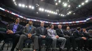 Members of the New York Islanders listen as
