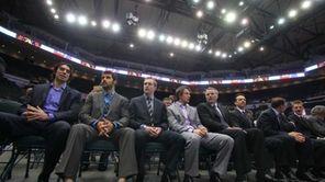 Members of the New York Islanders listen as
