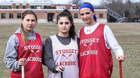 From left, Syosset girls lacrosse players Melissa Esswein,