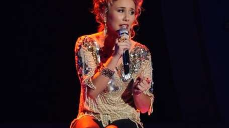 Haley Reinhart, wearing a glitz-laden ivory top featured