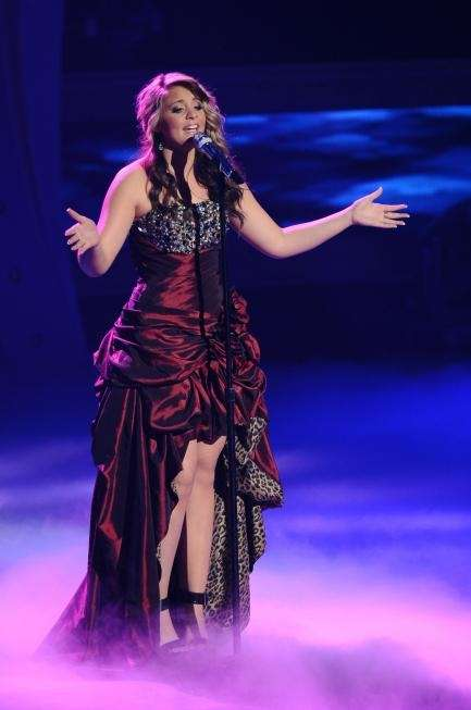 Lauren Alaina, wearing a burgundy gown (short in