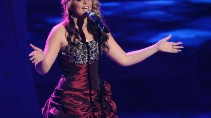 Lauren Alaina, wearing a burgundy gown (short in