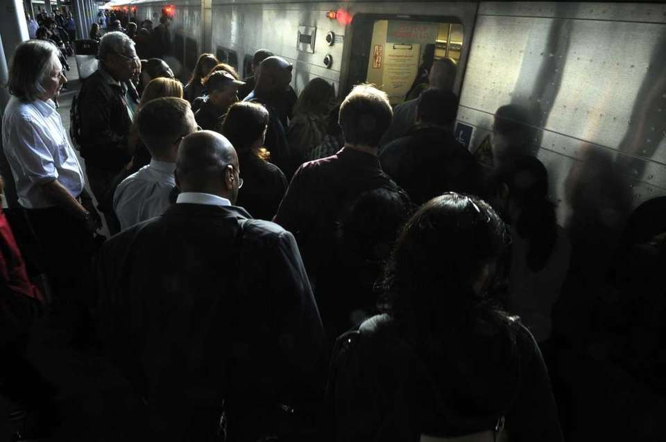 Long Island Rail Road commuters board a train