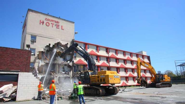 Demolition begins on the Courtesy Hotel, a motel