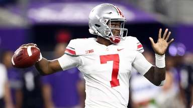 Dwayne Haskins of the Ohio State Buckeyes throws