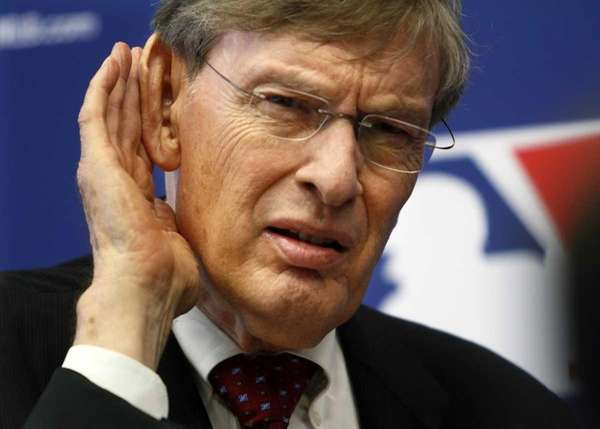 Baseball Commissioner Bud Selig listens to a question