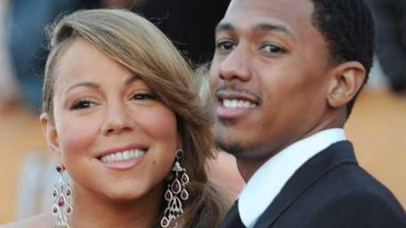 Singer Mariah Carey and husband Nick Cannon arrive
