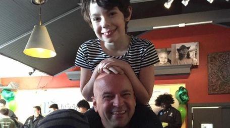 Kathren Mellon, 8, with her father, Pat Mellon,