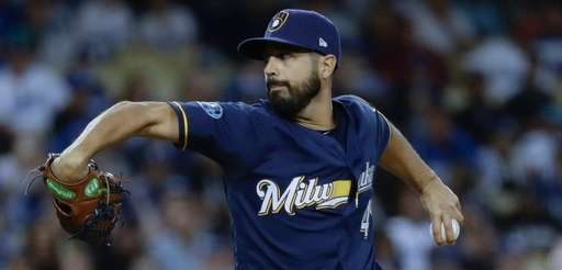 Brewers starting pitcher Gio Gonzalez throws during the