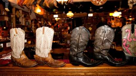 Cowboy boots, hats and other Western paraphernalia decorate