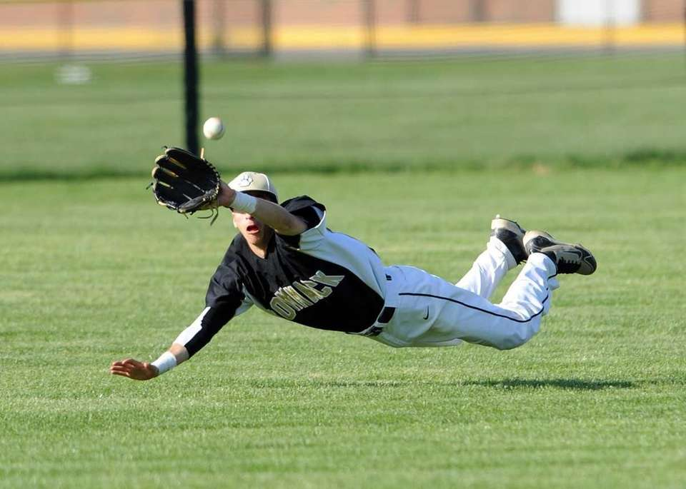 Commack's center fielder Jesse Mistretta dives and makes