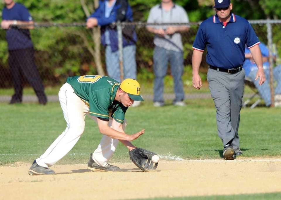 Ward Melville's Alex Morhaim makes the play at