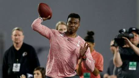 Ohio State quarterback Dwayne Haskins passes during an