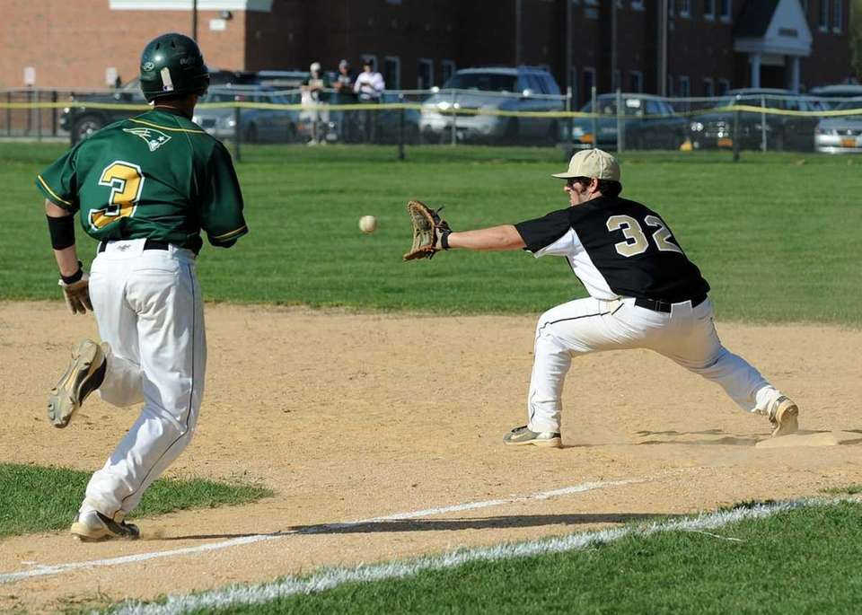 Ward Melville's Anthony Padrazo doesn't beat the throw
