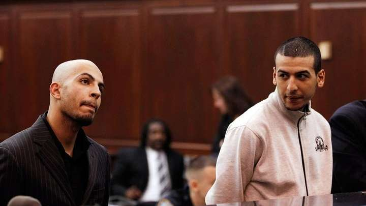 Mohamed Mamdouh, 20, stands before a judge during