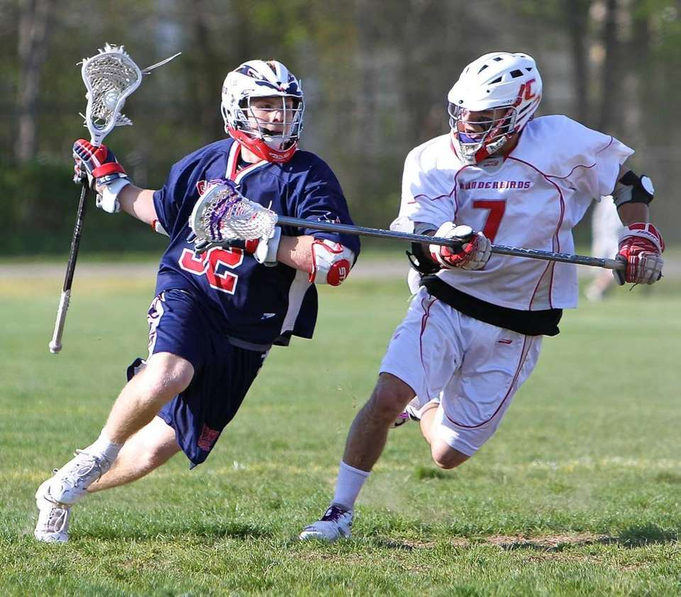 Connetquot defense Mike Pellegrino #7 stays close to
