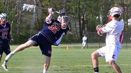 Smithtown West attack James Pannell #32 shoots and