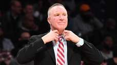 St. John's head coach Chris Mullin looks on