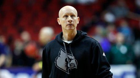 Louisville head coach Chris Mack watches his team