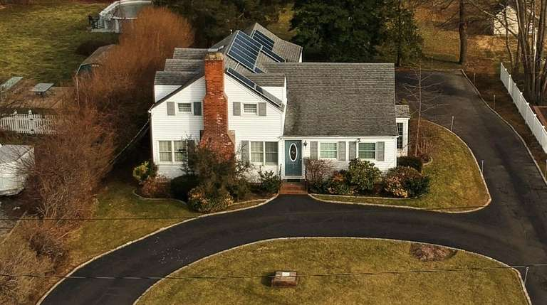 This Amityville home is listed for $575,000.