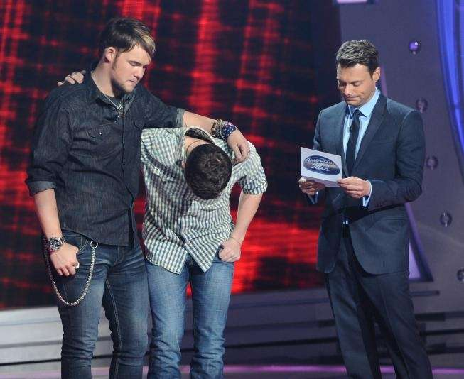 James Durbin and Scotty McCreery react after Ryan