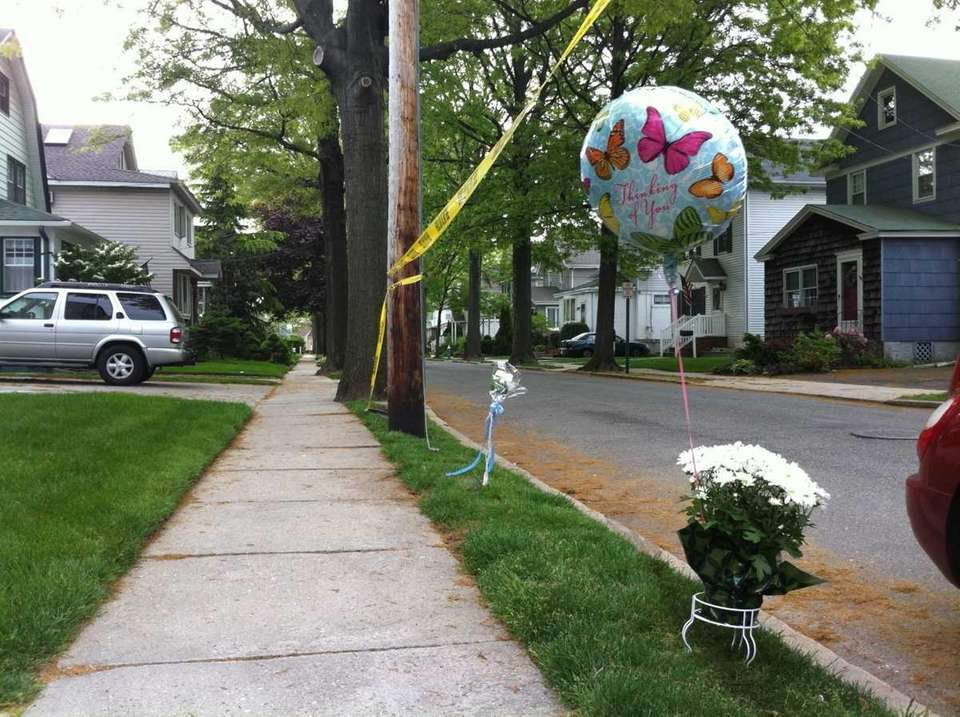 Flowers and a balloon mark the scene where