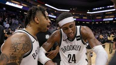 Nets' D'Angelo Russell, left, and Rondae Hollis-Jefferson celebrate