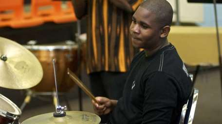 Fred Johnson, 12, rocks out on his drum