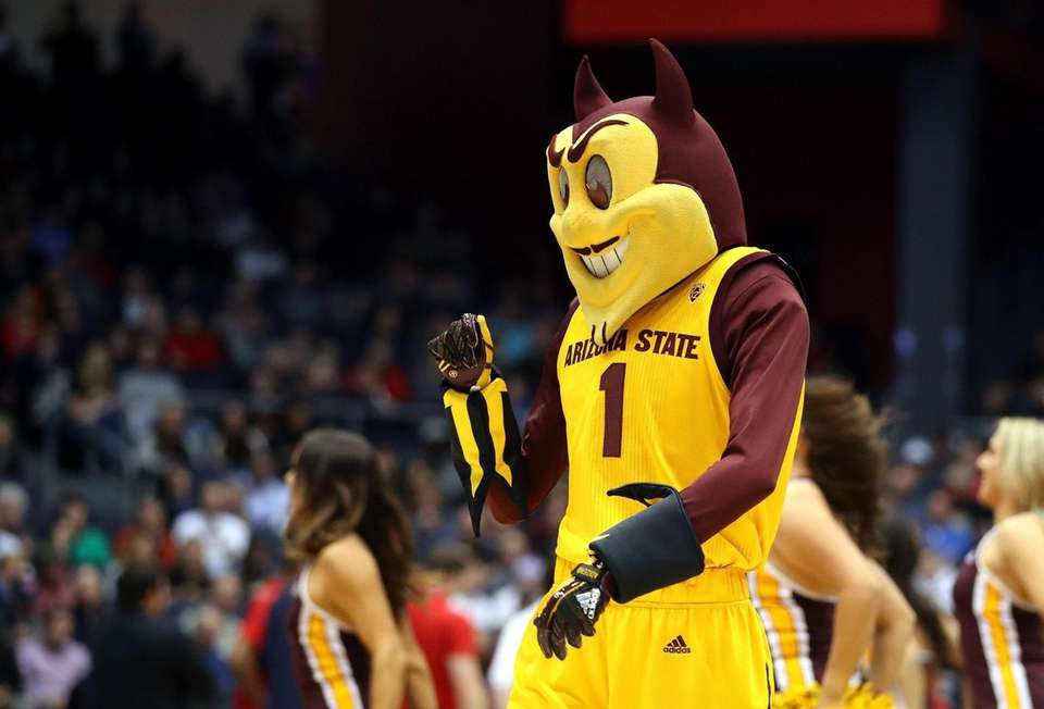 The Arizona State Sun Devils mascot performs during