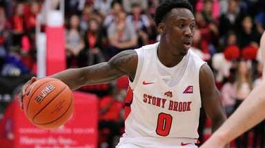 Stony Brook guard Jaron Cornish moves the ball