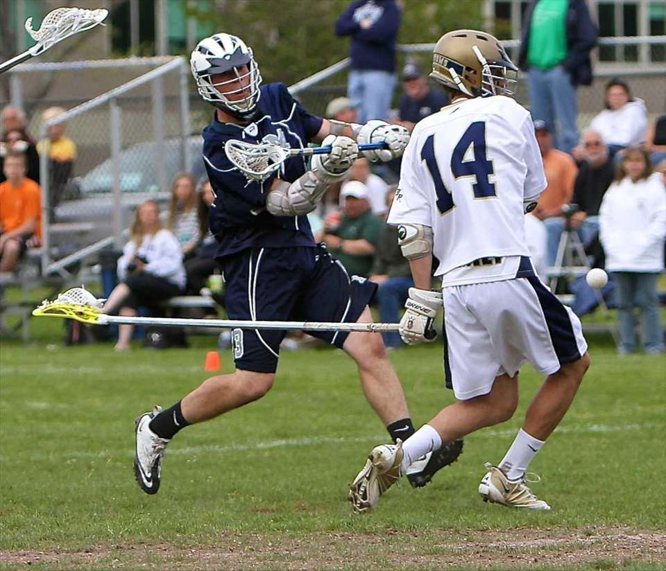 Eastport attack Alan Henderson, #13, scores on the
