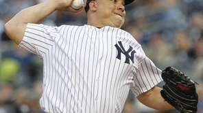 New York Yankees' Bartolo Colon delivers a pitch
