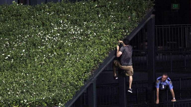 A fan eludes a police office by climbing