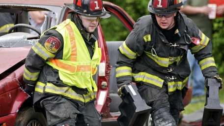 Firefighters compete during the fourth annual Chuck Varese