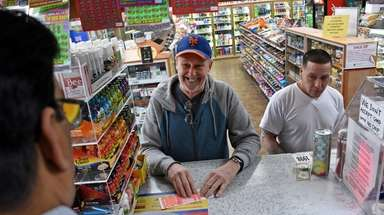 Bob McCord of East Meadow buys Powerball tickets