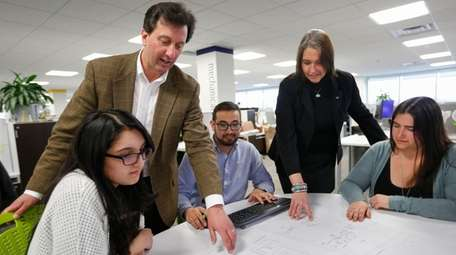 H2M Architects and Engineers CEO Rich Humann, standing,