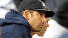 Yankees designated hitter Jorge Posada sits in the